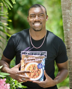 Julius Jackson hlds a copy of his new cookbook, 'My Caribbean Kitchen.' (Gerard Sperry photo)