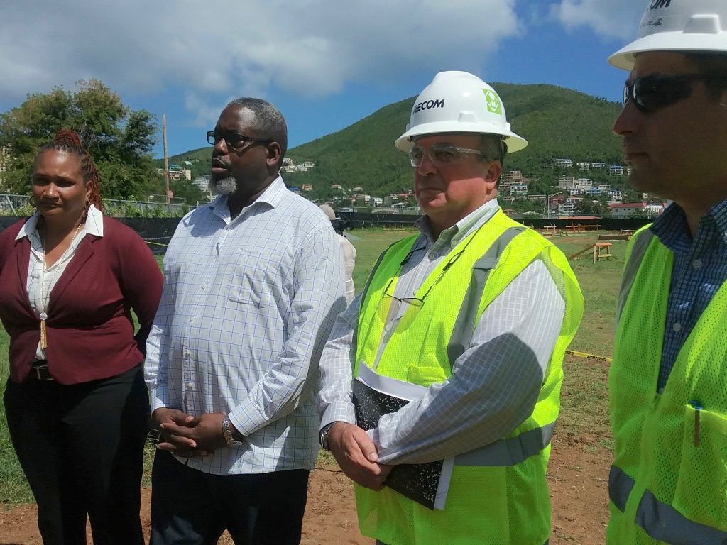 From left, Insular Superintendent Dionne Wells Hedrington, Education Department Chief of Staff Anthony Thomas and Aecom Project Director Pat Mitchell meet reporters to discuss progress on installing modular classrooms across the territory.