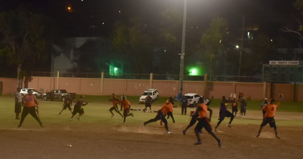 The Dynasty, in orange, run a pass play Saturday against the Archers in Summer League action. (Kyle Murphy photo)