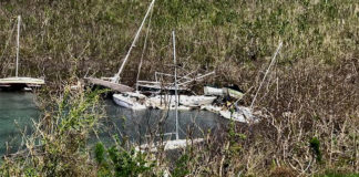 Some 50 boats that were damaged by Hurricane Irma still ring Hurricane Hole, but the Navy is on the way to remove the wrecks. (National Park Service photo)