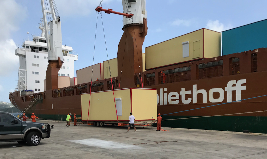 The first 80 modular units for the USVI schools arrive at St. Thomas Sunday. (Department of Education photo)