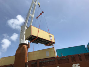 A modular classroom unit is lifted down from the ship that transported it to St. Thomas. (Department of Education photo)