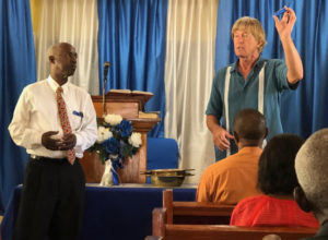 St. John Culture & Heritage Foundation Vice President Alvis Christian and volunteer Rick Barksdale distribute emergency flash lights at Cruz Bay Baptist Church in preparation for the 2018 hurricane season.