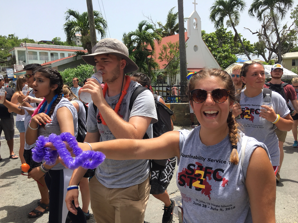 Volunteers from St. John Fisher College in Rochester, NY, get the Carnival spirit. (Amy Roberts photo)