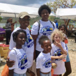 Members of the John's Folly Institute's summer camp posed at the Arts of Ages festival at the Annaberg sugar mill ruins.