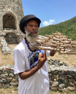 "Delroy "" Ital"" Anthony displays a kilivan used for trapping birds."