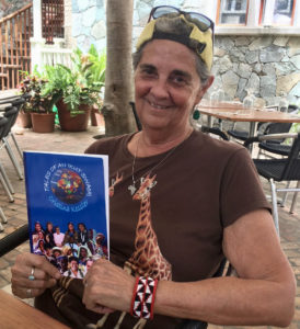 Christina Kessler holds her new book, 'Tales of an Ikut Swami,' on St. John. (Amy Roberts photo)