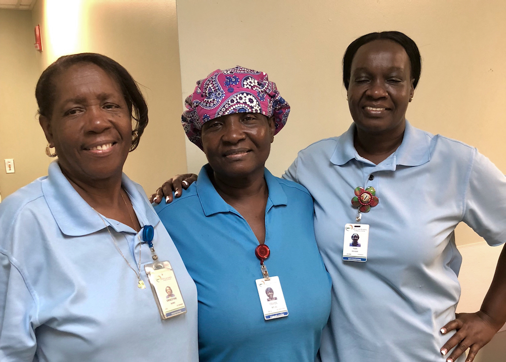 From left, JFL housekeeping staff members Ernestine Burke, Carol Felix and Tilda Rougier. The three were among 202 hospital employees targeted for $900 checks donation from from Greater New York Hospitals Association on Wednesday.