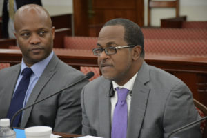 Budget Director Julio Rhymer addresses the Senate Finance Committee on Tuesday as Finance Commissioner Valdamier Collens listens. (Photo by Barry Leerdam, V.I. Legislature)