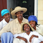 In 2006, Michelle Greene, center, and her daughters, from left, Amaris, Afiya and Asha, posed in a scene depicting Maroon culture. (Ted Davis photo)