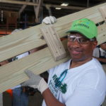 NYC Councilman Andy King helps My Brother's Workshop build tables for schools.