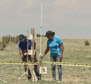 Steve and Subhasanie Bullock prepare their gold medal winning rocket for flight. (Photo from Steve Bullock's Facebook page)