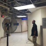 In August 2018, almost a year after the islands were battered by a pair of hurricanes, Schneider Hospital's VP of Facilities Darryl Smalls stands inside the largely abandoned administrative area on the hospital's second floor. (File photo)