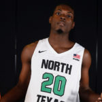 Shakeem Alcindor shows off his new uniform – of the University of North Texas. (Photo from Meangreensports.com)