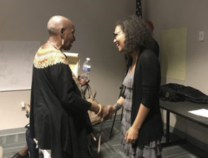Tahirah Abubakr left, greets Tuesday Ryan-Hart, at the St. Croix Foundation meeting.