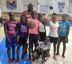Member of V.I. College Prospects pose with Clint Williams, head coach of the Women's V.I. national team, after a recent workout at the UVI Sports & Fitness Center.