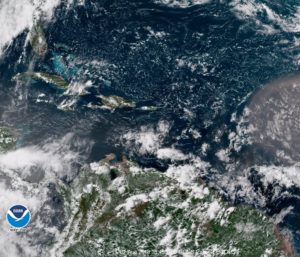 Satellite photo of the Caribbean at 12:45 p.m. AST shows a tropical wave nearing the islands. (NOAA photo)
