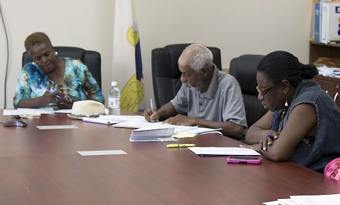 Board of Elections members work Monday to certify the August primary election results.