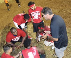 Canes coach Fernando Bryan instructs during Saturday's Flag Football League action, as the ream notched its first win of the season.