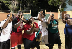 Men's Summer League players show team spirit after Friday's games.