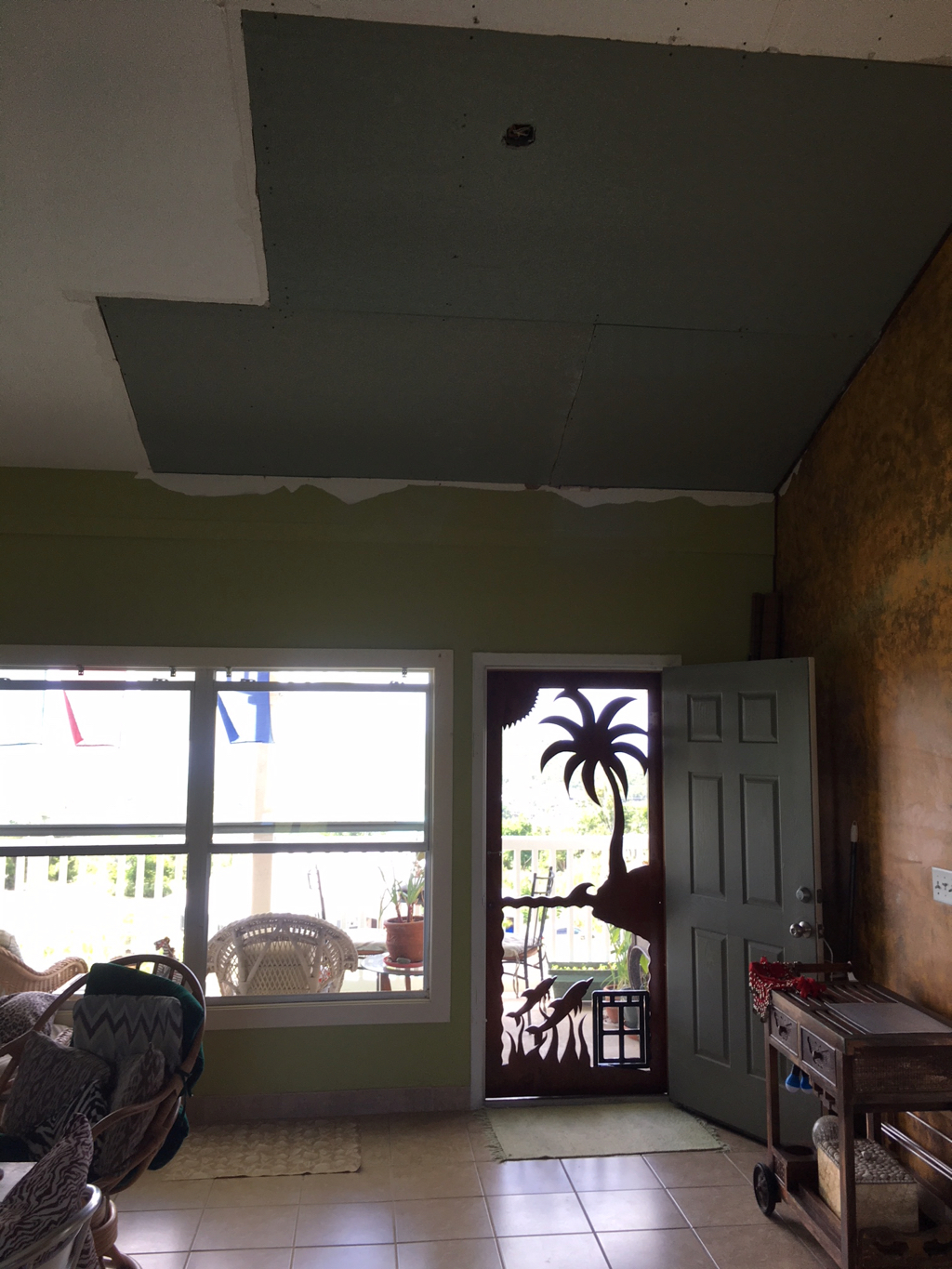 This patch on Keryn Bryan's ceiling was supposed to be temporary, but it's still there a year after the hurricanes hit.