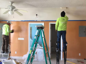 Workers perform repair work on a Bellevue Village apartment.