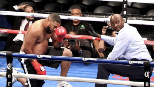 Sherman Artis, Jr. catches his breath after being dropped for the second time by V.I. heavyweight Clayton Laurent, Jr.