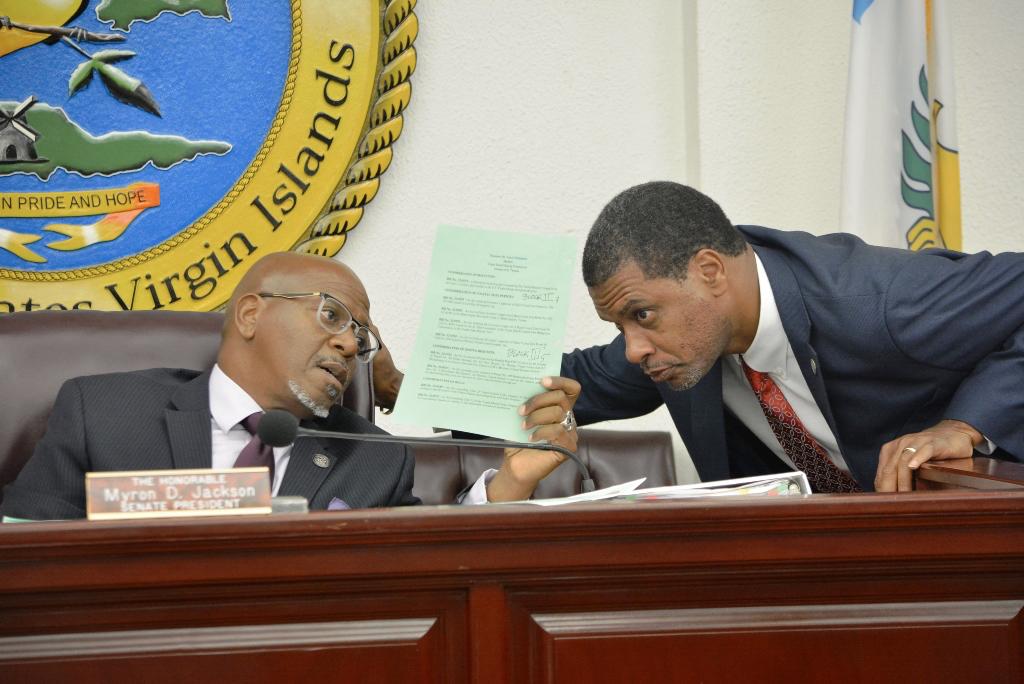 Senate President Myron Jackson and Sen. Kurt Vialet confer during Friday's session. (Photo by Barry Leerdam, V.I. Legislature)
