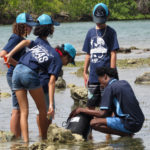 Mentor Amaziah George take students Kadejsha Tonge, Trevett Williams, Mireille Boumedine, Genai Ravalier on a Shoreline Trek to examine the species that live there. (Submitted photo)