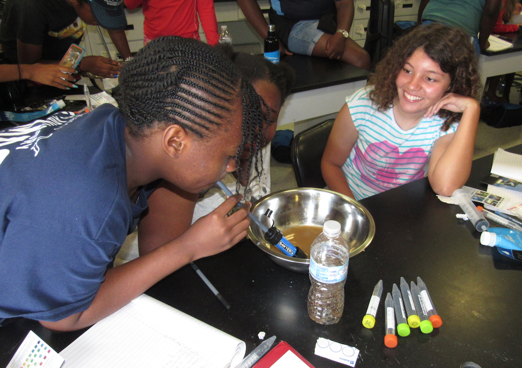 Sahara Durand, Anissa Wallen and Mireille Boumedine learn how to purify contaminated water. (Submitted photo)