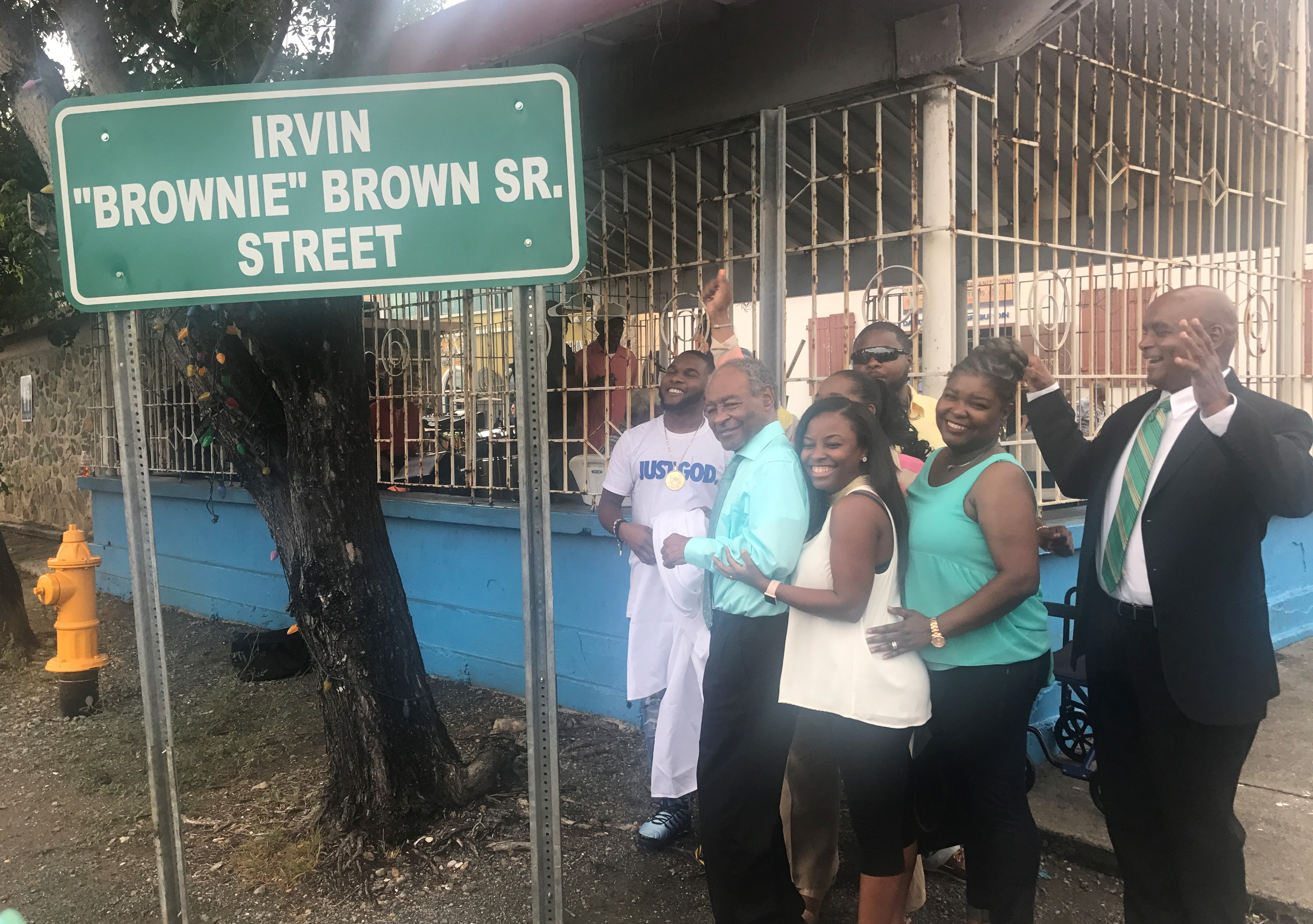 """Friends, family and admirers see unveiling of new sign naming Irvin  """"Brownie"""" Brown"""