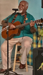 Doc Petersen entertains at the opening of Braata.