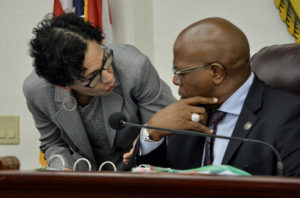 Sens. Nereida Rivera-O'Reilly (D-STX) and Myron Jackson (D-STT) confer during session Monday. (Photo by Barry Leerdam for the V.I. Legislature)