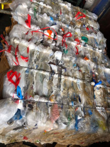 Bales of crushed plastic are waiting for be shipped to the mainland for recycling.