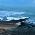 A drug-smuggling go-fast boat is beached in Luquillo, Puerto Rico, after being pursued by the Coast Guard Cutter Donald Horsley Saturday. (U.S. Coast Guard photo)