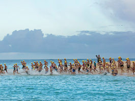 Swimmers at Buck Island hit the water for the start of the 23rd Annual Coral Reef Swim. (Image by Steve Simonsen Photography)