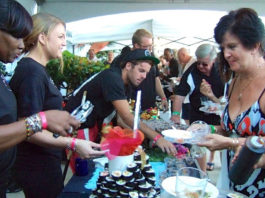 Foodies flock to a tasting table at the 2015 Taste of St. Croix.
