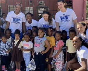 Members of the UCLA women's basketball team distribute new shoes and catch up with students at Joseph Gomez Elementary. (Photo by Jim Crawford, Basketball Travelers)