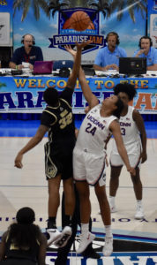 UConn's Napheesa Collier, 24 in the white, and Purdue's Ae'Rinna Harris, 32 in black, battle for the opening tip at the UVI's sports and Fitness in the Final Day of 2018 Paradise Jam.