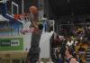 KSU's Xavier Sneed slams the ball home in transition.