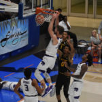 Tournament MVP Dean Wade scores on a putback dunk during second half action of Monday's Championship Game.
