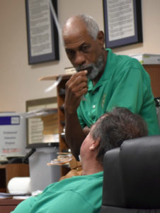 "Board of Elections members Arturo Watlington Jr. and Robert ""Max"" Schanfarber take a break while counting votes after the general election."