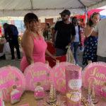 Edna Santiago of Mamacita's Coquito, pretty in pink, serves vegan-style at 2018 Coquito Festival. (Anne Salafia PHOTO)