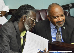 Sens. Positive T.A. Nelson, left, and Tregenza Roach, the sponsors of the medical cannabis bill, confer at Monday's committee hearing.