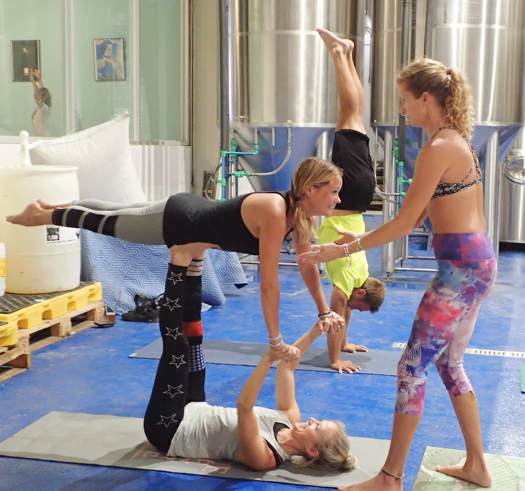 A group practices acu-yoga among the beer vats at Leatherback Brewery. (Susan Ellis photo)