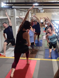 A yoga class overlooks the Leatherback brewing room. (Susan Ellis photo
