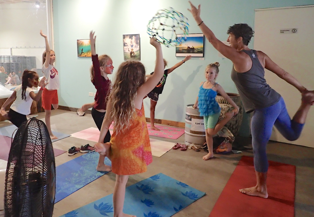 Yoga instructor Shera Evens and her young class practice the dancer pose. (Susan Ellis photo)