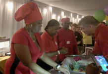 Kathlyn Reynold, chef and owner of Hot on the Spot, serves food to the hungry crowd at Taste of Two Islands.