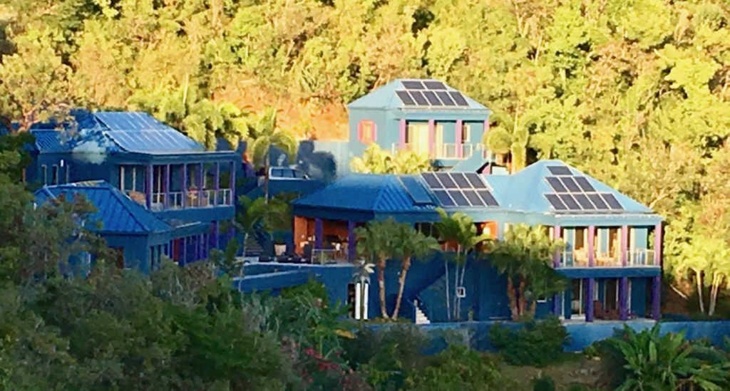 Solar panels cover the roof of a St. John hillside home.