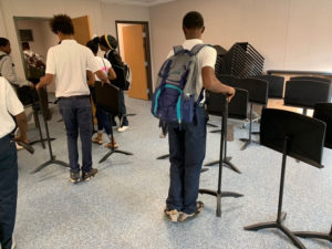Band students set up their new practice room as school gets underway on the Arthur Richards campus Monday.. (Anne Salafia photo)